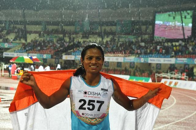 India's Dutee Chand has offered help to South African Olympic champion Caster Semenya over new rules on testosterone announced this week. (AFP Photo/Dibyangshu SARKAR)