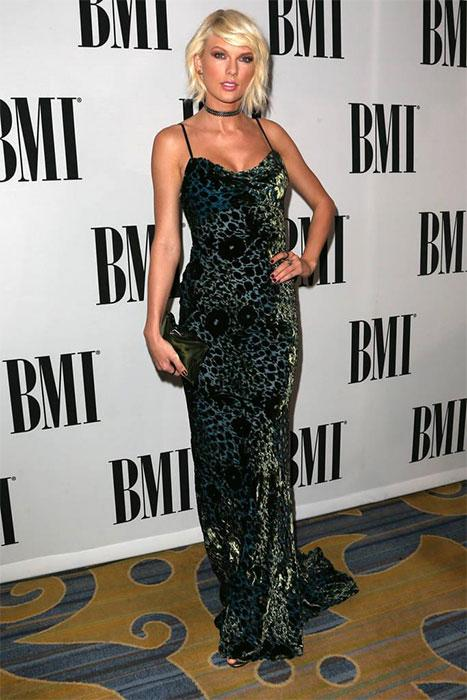 Taylor Swift posing at BMI event