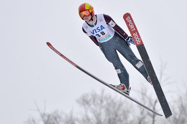 SAPPORO, JAPAN - JANUARY 11: Taylor Henrich of Canada competes in the normal hill individual during the FIS Women's Ski Jumping World Cup Sapporo at Miyanomori Ski Jump Stadium on January 11, 2014 in Sapporo, Japan. (Photo by Atsushi Tomura/Getty Images)