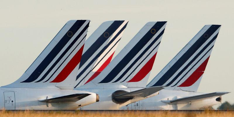 FILE PHOTO: Tails of Air France airplanes are seen at the Charles-de-Gaulle airport in Roissy