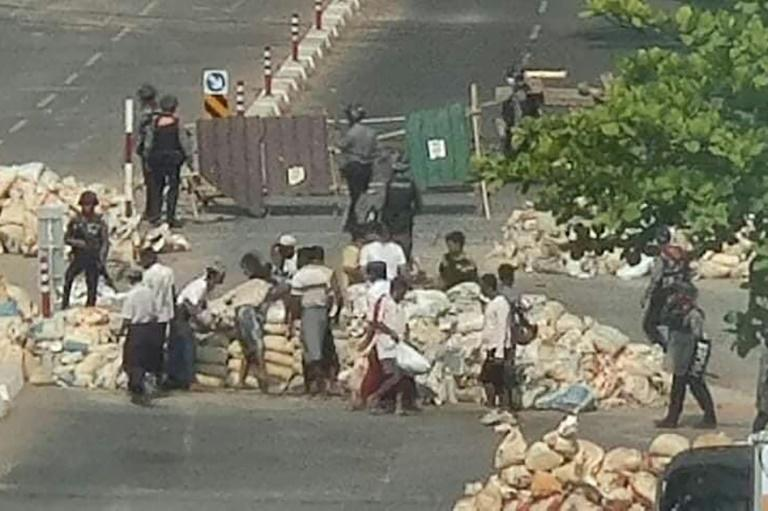 The Myanmar military is forcing civilians to dismantle barricades built by anti-coup protesters for protection against live rounds