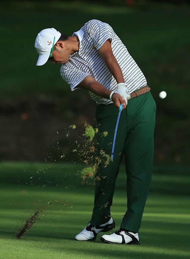 DUBLIN, OH - OCTOBER 03: Hideki Matsuyama of Japan and the International Team hits his third shot on the 15th hole during the Day One Four-Ball Matches at the Muirfield Village Golf Club on October 3, 2013 in Dublin, Ohio. (Photo by David Cannon/Getty Images)