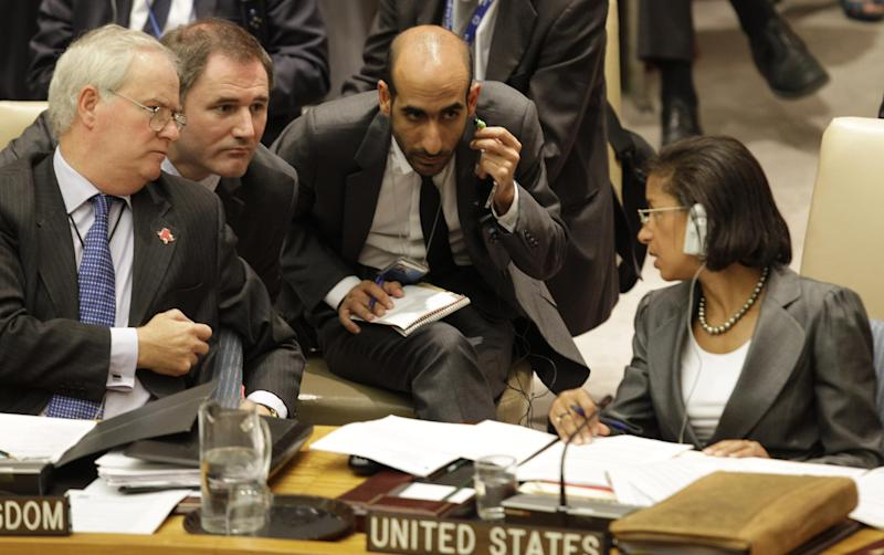 """United Kingdom U.N. Ambassador Mark Lyall Grant, far left, and United States U.N. Ambassador Susan Rice confer during a Security Council meeting on the situation in Syria at the United Nations in New York, Thursday, July 19, 2012. Russia and China have again vetoed a Western-backed U.N. resolution threatening non-military sanctions against Syria. Grant, who sponsored the resolution threatening non-military sanctions against Syria, said he was """"appalled"""" at the third double veto by Russia and China, allies of the Assad regime. (AP Photo/Kathy Willens)"""