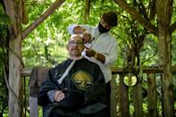Central Park barber Herman James, photographed cutting Joel Linchitz's hair on May 6, 2021, started the haircuts during lockdown