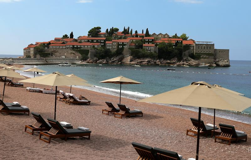 Pictured is beach near Sveti Stefan on the Adriatic coast of Montenegro, in 2019. Montenegro is the first European country to have no known active cases of coronavirus. Source: TASS/Getty Images