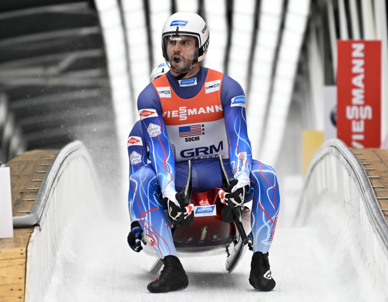 Chris Mazdzer and Jayson Terdiman of United States finish their team relay race at the Luge World Cup the World Cup luge relay event in Krasnaya Polyana, near the Black Sea resort of Sochi, southern Russia, Sunday, Feb. 16, 2020. (AP Photo/Artur Lebedev)