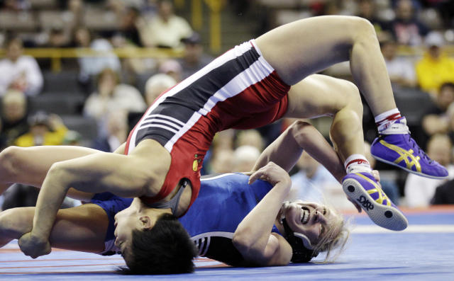 Alyssa Lampe, right, flips Clarissa Chun on her back during their 48-kilogram freestyle finals match at the U.S. Olympic Wrestling Team Trials, Sunday, April 22, 2012, in Iowa City, Iowa. (AP Photo/Charlie Neibergall)