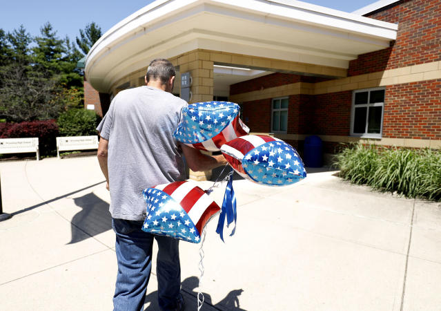 <p>A man brings balloons into Wyoming High School, site of tomorrow's funeral for Otto Warmbier June 21, 2017 in Wyoming, Ohio. (Photo: Bill Pugliano/Getty Images) </p>