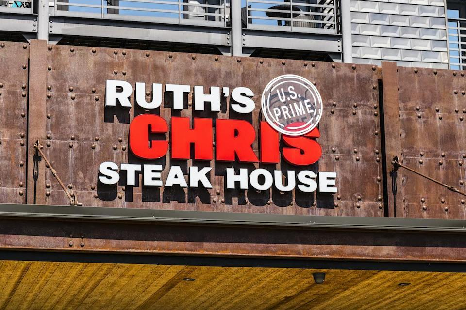 """<p>Ruth's Chris Steakhouse will be serving a three-course Thanksgiving dinner for dine-in customers at all open locations. The menu features sliced oven-roasted turkey, sausage and herb stuffing, homemade gravy, cranberry relish, appetizers, sides and desserts for $41.95 per adult and $14.95 per child. Each purchase receives """"leftovers"""" to bring home <a href=""""https://www.thedailymeal.com/holidays/thanksgiving-leftover-recipes-you-hadnt-thought-of?referrer=yahoo&category=beauty_food&include_utm=1&utm_medium=referral&utm_source=yahoo&utm_campaign=feed"""" rel=""""nofollow noopener"""" target=""""_blank"""" data-ylk=""""slk:to use in these next-day dishes"""" class=""""link rapid-noclick-resp"""">to use in these next-day dishes</a>.</p> <p>For those who would rather take their turkey day meal to go, Ruth's Chris is also offering a Thanksgiving takeout bundle for four, which includes all of the above menu items for $165.</p>"""