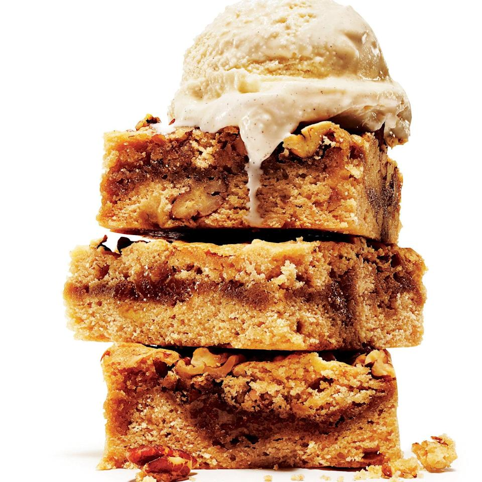 """A layer of brown butter in the middle makes these blondies really special. <a href=""""https://www.epicurious.com/recipes/food/views/gooey-brown-butter-blondies-with-pecans-51263720?mbid=synd_yahoo_rss"""" rel=""""nofollow noopener"""" target=""""_blank"""" data-ylk=""""slk:See recipe."""" class=""""link rapid-noclick-resp"""">See recipe.</a>"""
