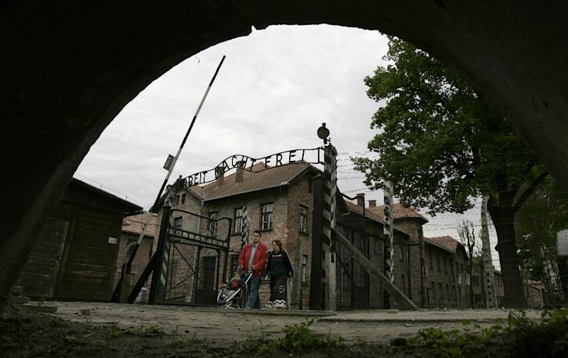 A family crosses the gate of the Nazi concentration camp of Auschwitz in Poland, where some 1.1 million people, most of them European Jews, perished between 1940 and 1945 (AFP Photo/Joe Klamar)