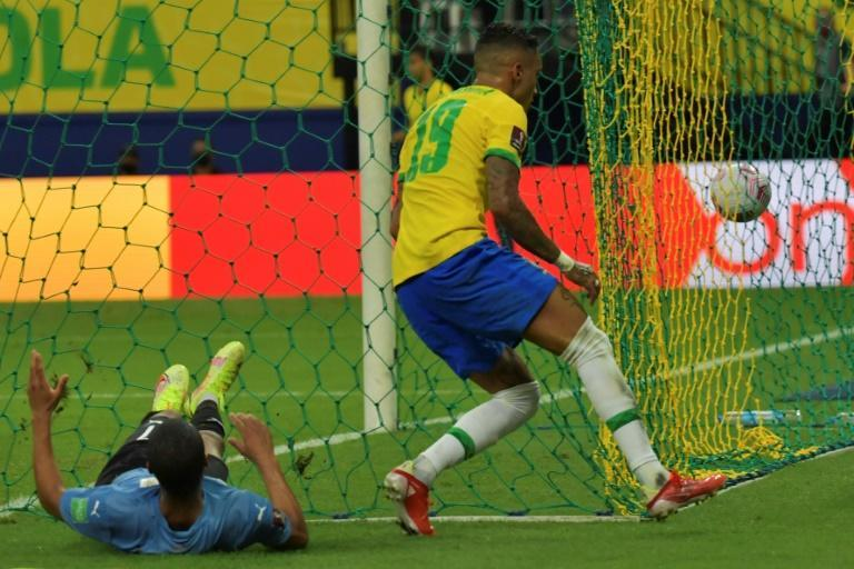 Raphinha (right) scored a brace on his first start for Brazil (AFP/NELSON ALMEIDA)