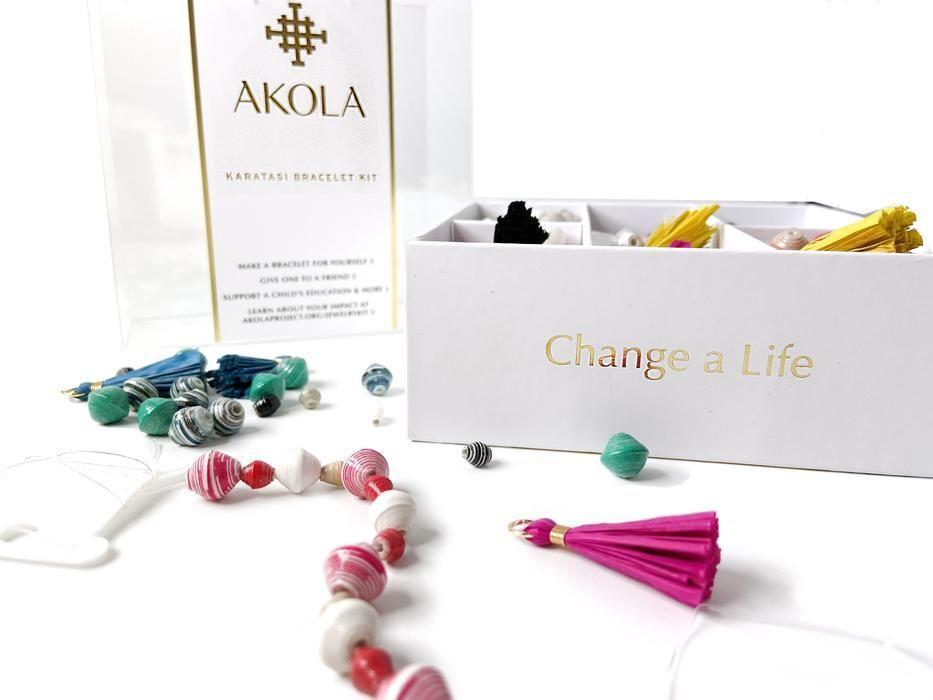 """<p><strong>Akola </strong></p><p>akola.co</p><p><strong>$49.99</strong></p><p><a href=""""https://go.redirectingat.com?id=74968X1596630&url=https%3A%2F%2Fakola.co%2Fcollections%2Fjust-in%2Fproducts%2Fbead-kit&sref=https%3A%2F%2Fwww.goodhousekeeping.com%2Fholidays%2Fgift-ideas%2Fg1405%2Fgifts-for-her%2F"""" rel=""""nofollow noopener"""" target=""""_blank"""" data-ylk=""""slk:Shop Now"""" class=""""link rapid-noclick-resp"""">Shop Now</a></p><p>With this box of beads, raffia tassels, and stretch cord, she'll be able to craft up to seven bracelets of her own in varying colors and styles. She may even be able to enlist the help of her kids on a rainy day.</p>"""