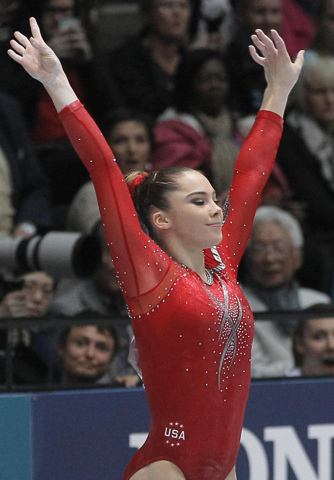 McKayla Maroney from the U.S. finishes her routine on the vault, during the qualification round at the artistic gymnastics World Championships in Antwerp, Belgium, Wednesday, Oct. 2, 2013. The event takes place until Sunday, Oct. 6. (AP Photo/Yves Logghe)
