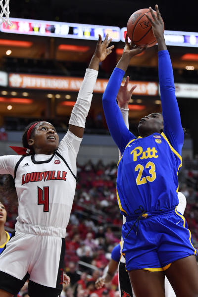 Louisville guard Elizabeth Balogun (4) attempts to block the shot of Pittsburgh forward Rita Igbokwe (23) during the first half of an NCAA college basketball game in Louisville, Ky., Sunday, Jan. 26, 2020. (AP Photo/Timothy D. Easley)