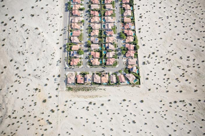 """A housing development on the edge of undeveloped desert in Cathedral City, Calif., on April 3, 2015, during the state's punishing drought. <span class=""""copyright"""">Damon Winter—The New York Times/Redux.</span>"""