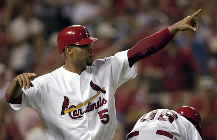 Albert Pujols celebrates during a game between the St. Louis Cardinals and San Diego Padres in July 2008.