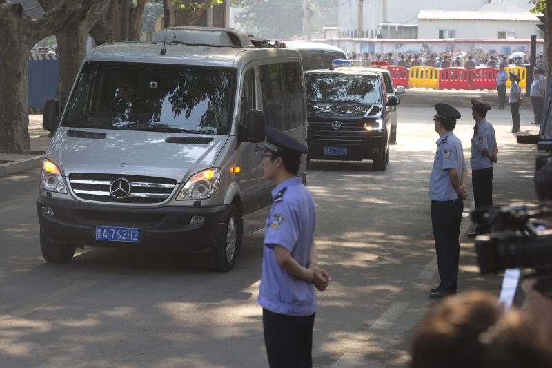 Vehicles that are part of a convoy believed to be transporting former Chinese politician Bo Xilai arrive at the Jinan Intermediate People's Court in Jinan, in eastern China's Shandong province on Thursday, Aug. 22, 2013. Former Chinese politician Bo Xilai will stand trial at the court on Thursday on charges of corruption and abuse of power. (AP Photo/Ng Han Guan)