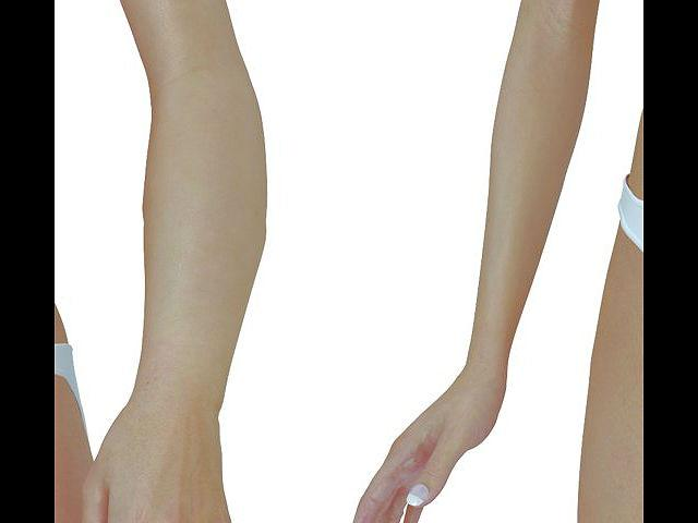 Barbie's arms are way skinnier than average (and in an uncomfortable position, to boot).