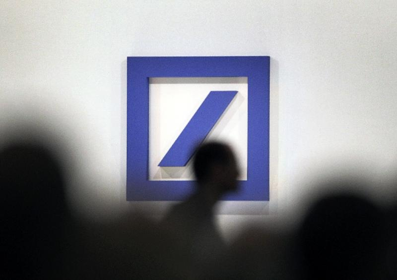 Deutsche Bank saw a fourth quarter loss of 1.9bn euros, affected by $7.2bn it agreed to pay in fines and compensation in the US over the mortgage-backed securities crisis of 2008 (AFP Photo/DANIEL ROLAND)