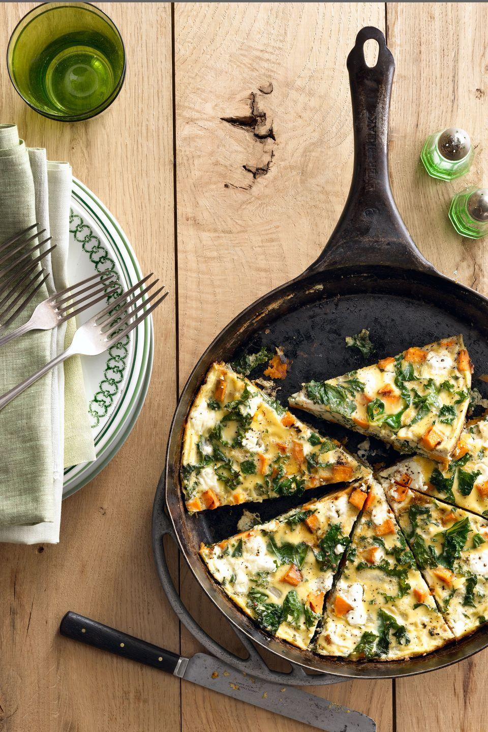 """<p>A delicious and easy frittata that is perfect for breakfast, lunch, or dinner.</p><p><strong><a href=""""https://www.countryliving.com/food-drinks/recipes/a5502/sweet-potato-kale-frittata-recipe-clx0914/"""" rel=""""nofollow noopener"""" target=""""_blank"""" data-ylk=""""slk:Get the recipe"""" class=""""link rapid-noclick-resp"""">Get the recipe</a>.</strong></p>"""