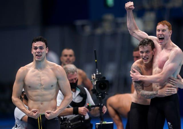 Dean celebrates with James Guy, left, and Matthew Richards after Scott anchored the team to victory