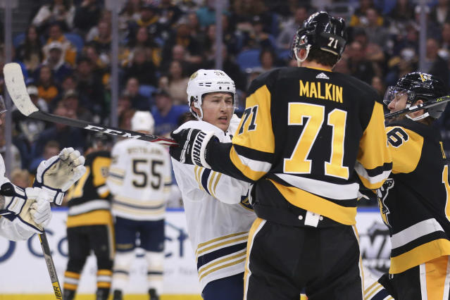Buffalo Sabres defenseman Brandon Montour (62) is defended by Pittsburgh Penguins forward Evgeni Malkin (71) during the second period of an NHL hockey game Thursday, March 5, 2020, in Buffalo, N.Y. (AP Photo/Jeffrey T. Barnes)