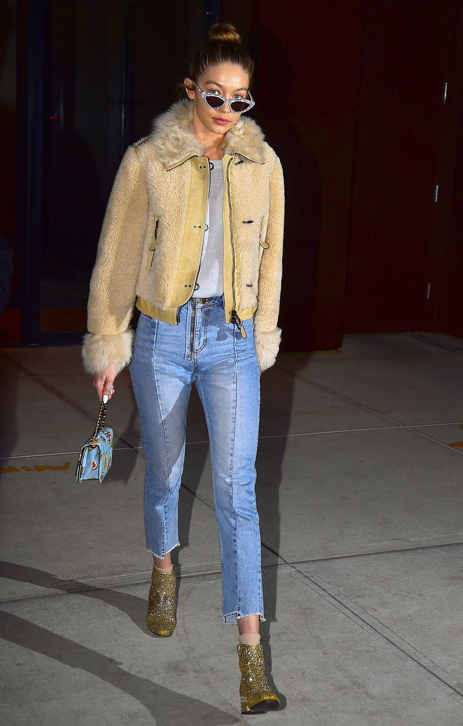 <p>The best way to make a white tee and jeans look fashion af: add glitter shoes, a funky coat, and some statement shades. </p>