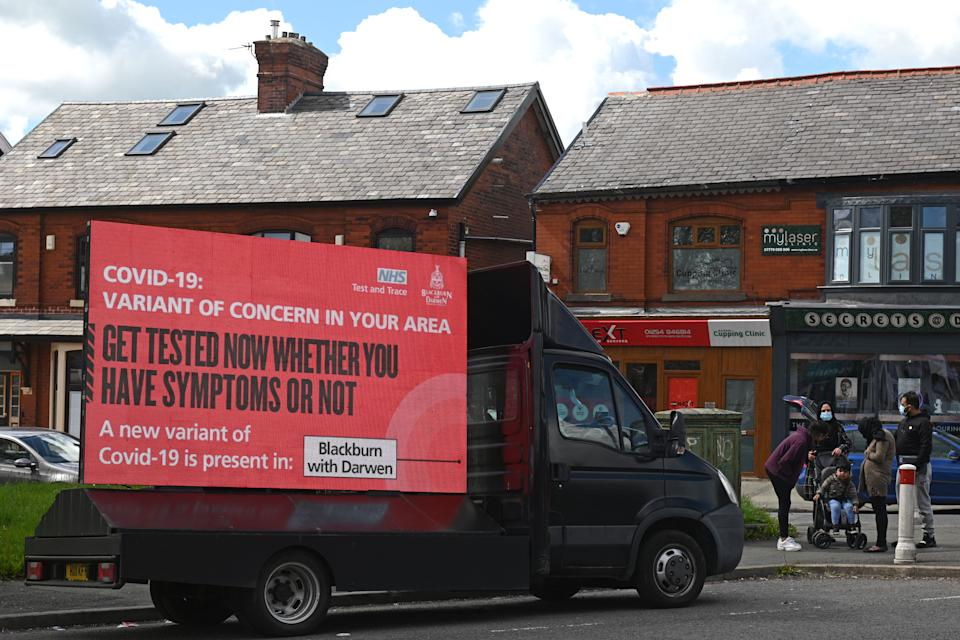 Information advising people to get tested due to the prevalence of a coronavirus covid-19 variant is displayed on a screen attached to a vehicle on the streets of Blackburn, in north-west England on May 19, 2021. - British Prime Minister Boris Johnson said Wednesday that Covid-19 vaccines are proving effective against a highly contagious coronavirus variant, first discovered in India, as he was pressed on why the government is allowing travel from hotspots. (Photo by Oli SCARFF / AFP) (Photo by OLI SCARFF/AFP via Getty Images)