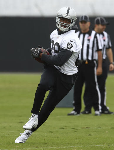 Oakland Raiders' Amari Cooper runs during NFL football practice on Tuesday, May 22, 2018, at the team's training facility in Alameda, Calif. (AP Photo/Ben Margot)
