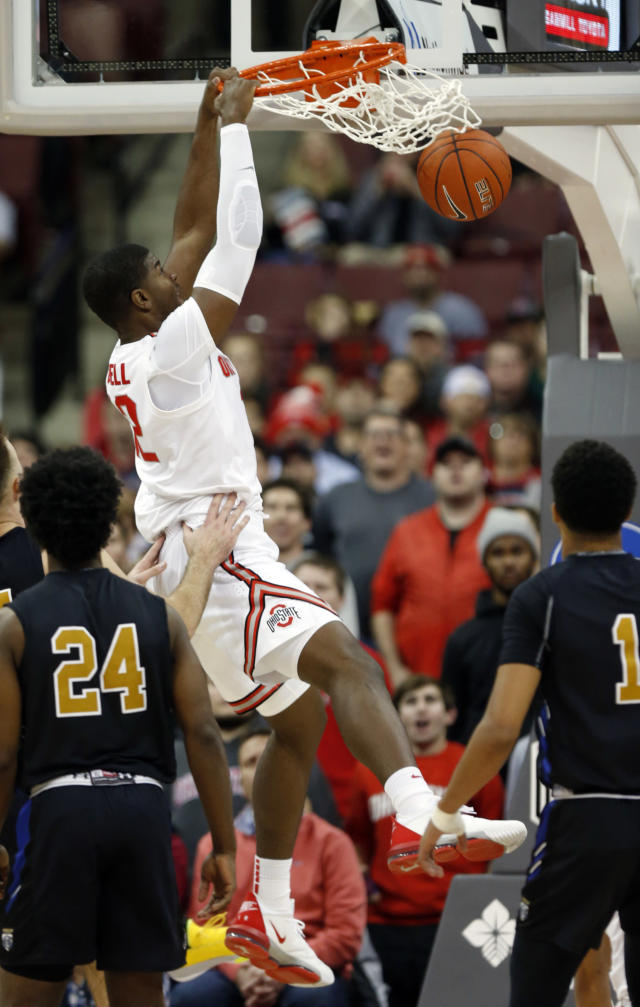 Ohio State forward E.J. Liddell, center, dunks the ball between Purdue Fort Wayne guard DeMierre Black, left, and guard Jarred Godfrey during the first half of an NCAA college basketball game in Columbus, Ohio, Friday, Nov. 22, 2019. (AP Photo/Paul Vernon)