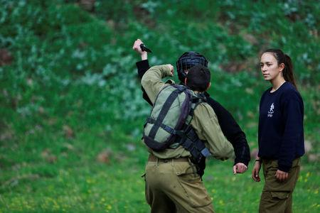 Female Israeli soldier, Lotem Stapleton (R), a physical education officer, oversees a training session in Krav Maga, an Israeli self-defence technique, at a military base in the Israeli-occupied Golan Heights March 1, 2017. REUTERS/Nir Elias