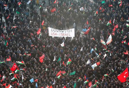 Demonstrators wave Turkish and Palestinian flags during a protest against U.S. President Donald Trump's recognition of Jerusalem as Israel's capital, in Istanbul, Turkey December 10, 2017. REUTERS/Osman Orsal