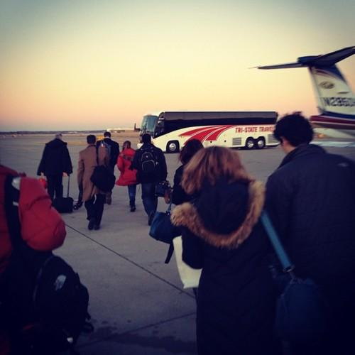 Either this bus is taking us to the Romney plane or we are flying to NH Spaceballs style. Photo by Holly Bailey/Yahoo!