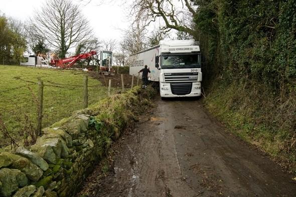 Tight spot! How Many Men Does It Take To Rescue A 40ft Lorry From A Country Lane?