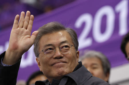 Short Track Speed Skating Events - Pyeongchang 2018 Winter Olympics - Women's 1500m - Gangneung Ice Arena - Gangneung, South Korea - February 17, 2018 - South Korea's President Moon Jae-in waves. REUTERS/John Sibley
