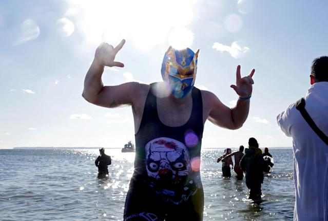 <p>Polar Bear Club swimmers make their annual icy plunge into the Atlantic Ocean on New Year's Day, January 1, 2018, at Coney Island in the Brooklyn borough of New York City. (Photo: Yana Paskova/Getty Images) </p>