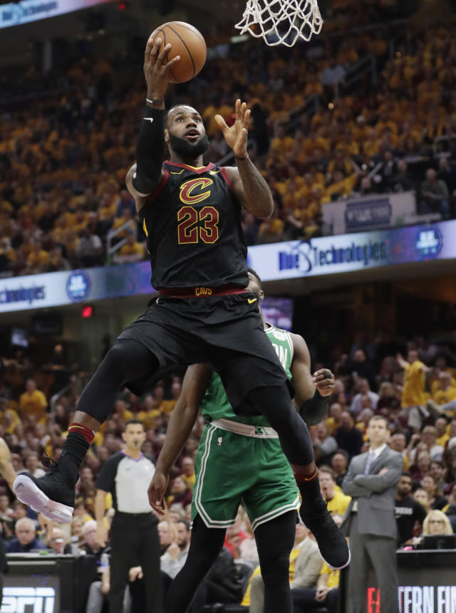 Cleveland Cavaliers' LeBron James (23) shoots against the Boston Celtics in the first half of Game 3 of the NBA basketball Eastern Conference finals, Saturday, May 19, 2018, in Cleveland. (AP Photo/Tony Dejak)