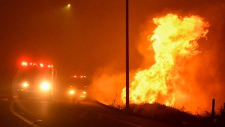 Firefighters battle a wind-driven wildfire in Sylmar, California