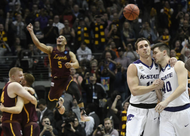 Kansas State's Mason Schoen, left, and Kade Kinnamon (40) leave the court after losing to Loyola-Chicago. (AP)