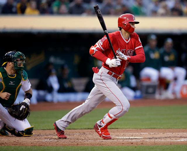 Los Angeles Angels' Shohei Ohtani singles off Oakland Athletics' Frankie Montas in the second inning of a baseball game, Tuesday, May 28, 2019, in Oakland, Calif. (AP Photo/Ben Margot)