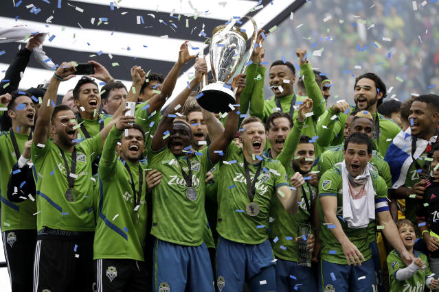 The Seattle Sounders celebrate after beating Toronto FC 3-1 Sunday to win their second MLS Cup title. (AP Photo/Elaine Thompson)