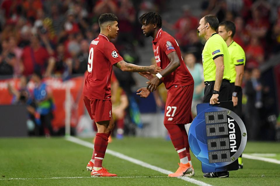 Roberto Firmino of Liverpool is replaced as a substitute by teammate Divock Origi (Photo by Matthias Hangst/Getty Images)
