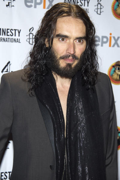 "FILE - In this March 4, 2012 file photo, Russell Brand arrives to Amnesty International's ""Secret Policeman's Ball"" in New York. Brand will host the 2012 MTV Movie Awards on Sunday, June 3, 2012. (AP Photo/Charles Sykes, File)"