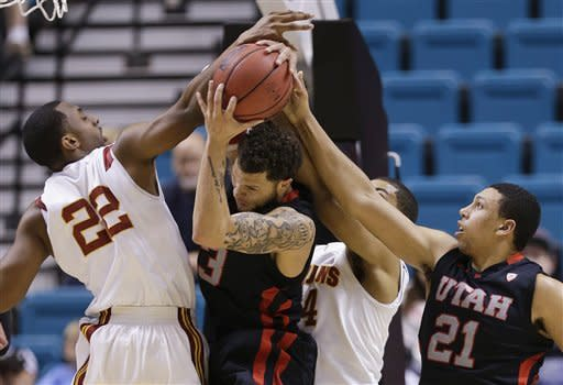 Utah's Cedric Martin, second from left, pulls down a rebound with help from Jordan Loveridge (21) against USC's Byron Wesley (22) and Eric Wise in the first half during a Pac-12 tournament NCAA college basketball game on Wednesday, March 13, 2013, in Las Vegas. (AP Photo/Julie Jacobson)