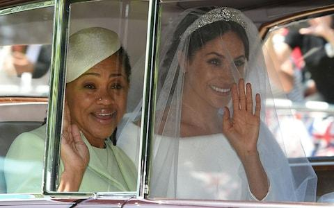 Meghan Markle and her mother Doria Ragland travel to St George's Chapel - Credit: AFP