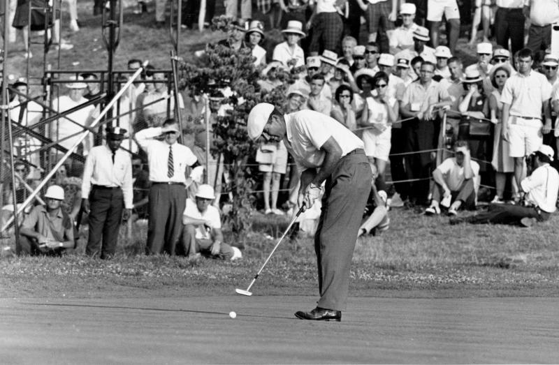 File-This June 20, 1964 file photo shows Ken Venturi making the final putt on the 18th green during the U.S. Open Golf Championship at Congressional Country Club in Bethesda, Md. The former U.S. Open champion has died just 12 days after he was inducted into the World Golf Hall of Fame. He was 82. His son, Matt Venturi, says he died Friday May 17, 2013 in a hospital in Rancho Mirage, Calif. Venturi had been hospitalized the last two months for a spinal infection, pneumonia and an intestinal infection. (AP Photo/File)
