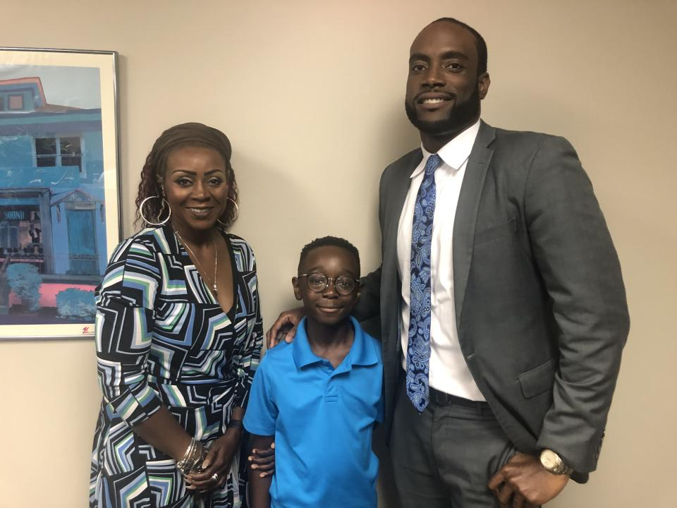 Canton boy previously charged with aggravated assault smiles next to his mother, Cameishi Lindley and his defense attorney, Maurice Davis. (Photo: Maurice Davis)