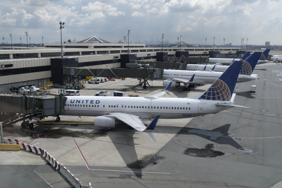 FILE - In this Wednesday, July 1, 2020, file photo, United Airlines planes are parked at gates at Newark Liberty International Airport in Newark, N.J. Congress' $900 billion pandemic relief package, which passed Monday, Dec. 21, 2020, includes $15 billion for the airline industry and an extension of their Payroll Support Program from the previous rescue bill in March. (AP Photo/Seth Wenig, File)