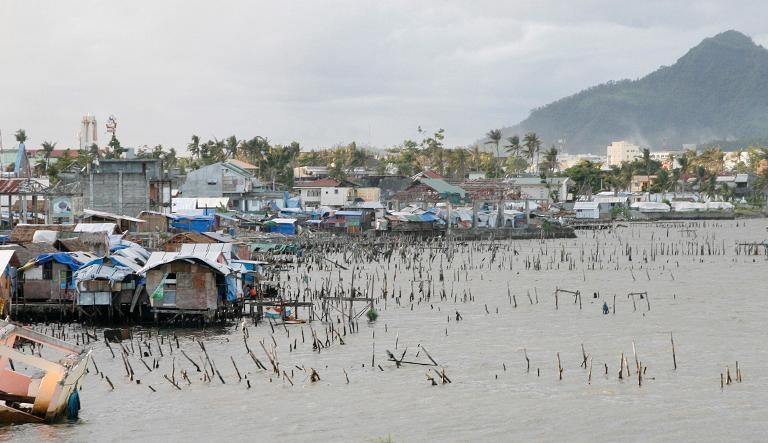 The coastline of Tacloban City on May 7, 2014, still bears scars from the massive damage left by Super Typhoon Haiyan that devastated the central Philippine city six months ago
